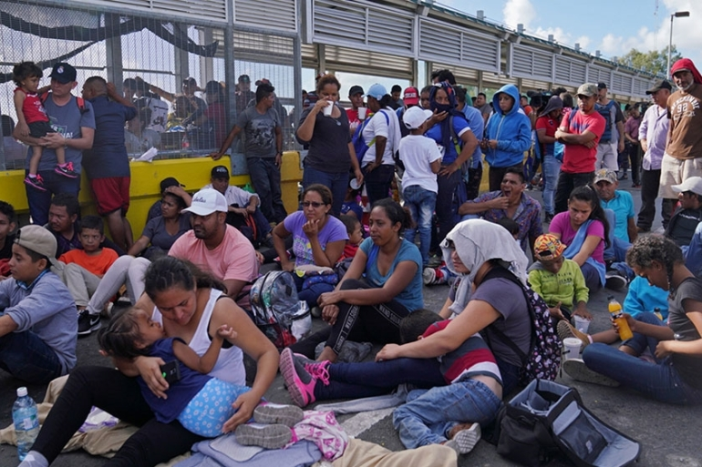 Asylum seekers occupy US-Mexico border bridge, crossing closed | Migration  News | Al Jazeera