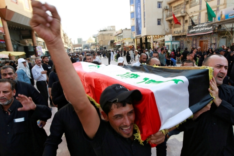Iraqi men carry the coffin of a demonstrator who was killed during anti-government protests in Najaf [Alaa al-Marjani/Reuters]