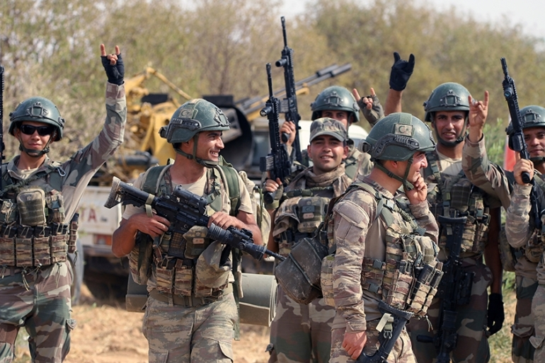 In this Monday, Oct. 14, 2019 photo, Turkish troops deploy in Syria''s northern region of Manbij. Syrian state media said Tuesday that government forces have entered the center of the once Kurdish-held northern town of Manbij and raised the national flag. (AP Photo) [The Associated Press]
