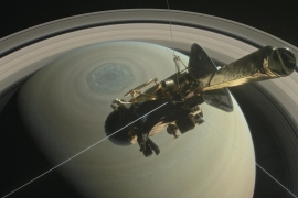 The spacecraft Cassini is pictured above Saturn's northern hemisphere prior to making one of its Grand Finale dives in this NASA handout illustration [NASA/Handout via Reuters]