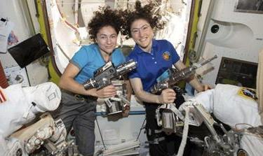 US astronauts Jessica Meir, left, and Christina Koch, right, are scheduled to perform the first all-women spacewalk on Friday, but if the US is to maintain its competitiveness in space, the commercial industry that supports it needs to work harder to recruit and retain qualified women, say experts [File: NASA via AP]