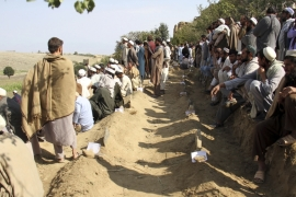 Police and local people searched on Saturday for more bodies in the rubble of the mosque [Wali Sabawoon/AP]