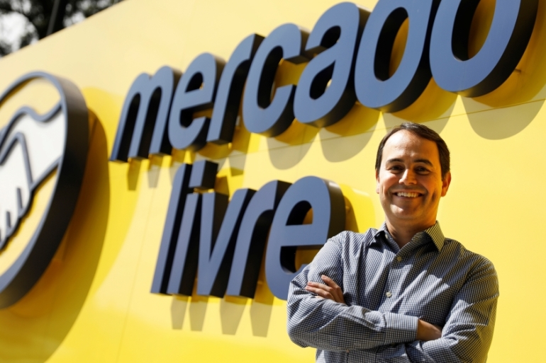 Stelleo Tolda, Chief Operating Officer of MercadoLibre - known in Portuguese as MercadoLivre - poses at the entrance of the company's headquarters in Sao Paulo, Brazil [Nacho Doce/Reuters]