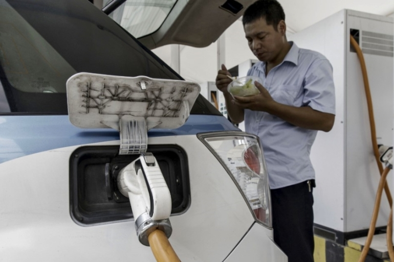 China reportedly wants 60 percent of all vehicles sold in the country to run on electric motors by 2035, and the number of charging stations is growing rapidly to meet that goal, analysts say [File: Qilai Shen/Bloomberg]