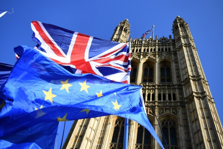British and European Union flags fly outside Parliament in London [File: Andy Rain/EPA]