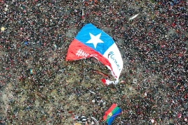 In this aerial view, thousands of people protest in Santiago [Pedro Ugarte/AFP]