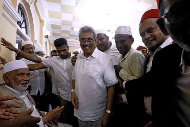 The appeals court has cleared the way for Gotabaya Rajapaksa, centre, to register as a candidate in the November presidential election [Dinuka Liyanawatte/Reuters]
