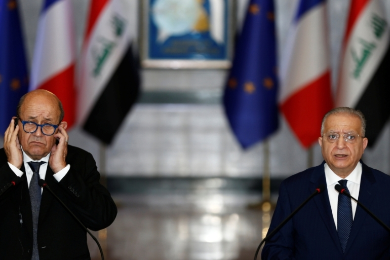 French Foreign Minister Yves le Drian speaks with his Iraqi counterpart Mohammed Ali al-Hakim at the Ministry of Foreign Affairs in Baghdad [Khalid al-Mousily/Reuters]