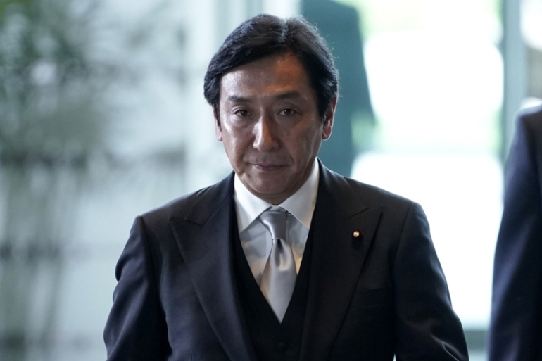 Isshu Sugawara, who was appointed as Japan's economy minister in September, said he did not want his 'problems to slow down parliament deliberations' [File: Kiyoshi Ota/Bloomberg]