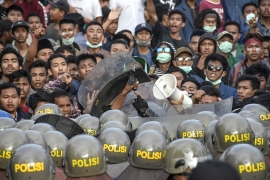 About 24,000 soldiers and police were deployed to secure key locations, including the presidential palace in Jakarta on Tuesday [Arsyad Ali/AFP]