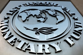 The International Monetary Fund (IMF) logo is seen outside the headquarters building in Washington, US [Yuri Gripas/Reuters]