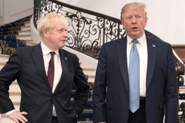 Britain's Prime Minister Boris Johnson and US President Donald Trump are seen together during the G7 summit in Biarritz, France on August 25, 2019 [Stefan Rousseau/Pool via Reuters]