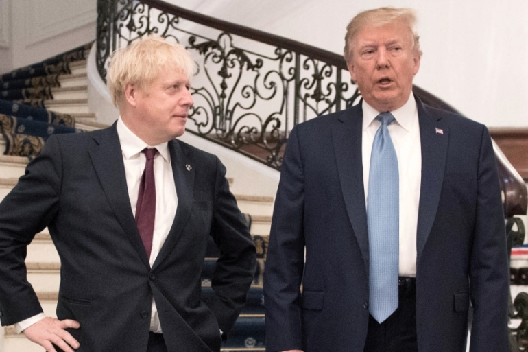 UK's Prime Minister Boris Johnson and US President Donald Trump are seen together during the G7 summit in Biarritz, France on August 25, 2019 [File: Stefan Rousseau/Pool via Reuters]