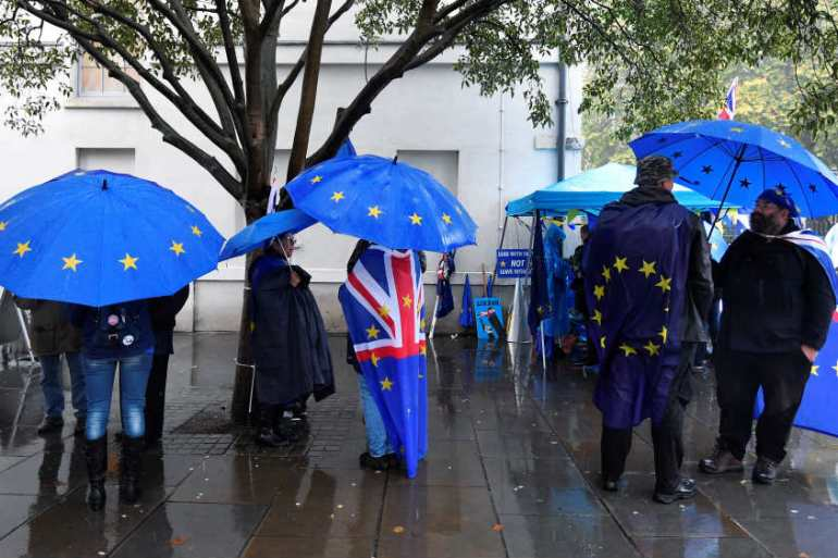 EU-supporters have been gathering in the rain outside the Houses of Parliament, along with anti-EU protesters [Toby Melville/Reuters]
