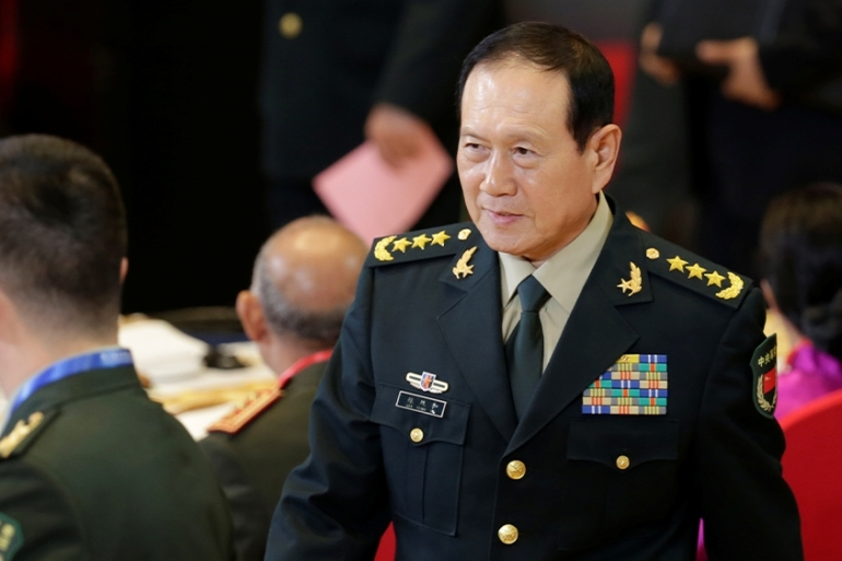 The Chinese defence minister, Wei Fenghe, reiterated China's claim over the island of Taiwan at a security forum in Beijing. [Jason Lee/Reuters]
