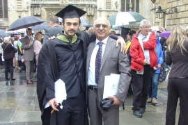 Aryan Ashoori, left, poses with his father Anoosheh after graduating in 2012 [Courtesy: Elika Ashoori]