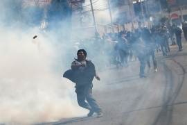 Police used tear gas on protesters in La Paz on Tuesday. [Kai Pfaffenbach/Reuters]