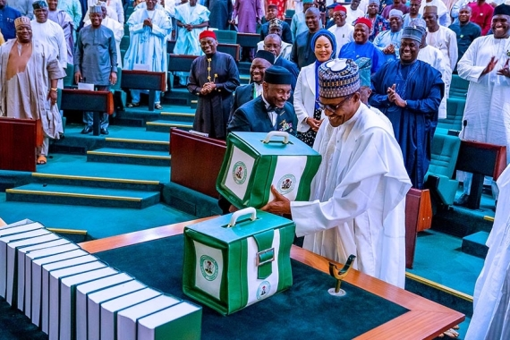 Nigerian President Muhammadu Buhari told lawmakers at a joint session of the upper and lower chambers of parliament that the 'economic environment remains challenging' but that the budget was expected to increase the pace of growth [Nigeria Presidency/Handout via Reuters]