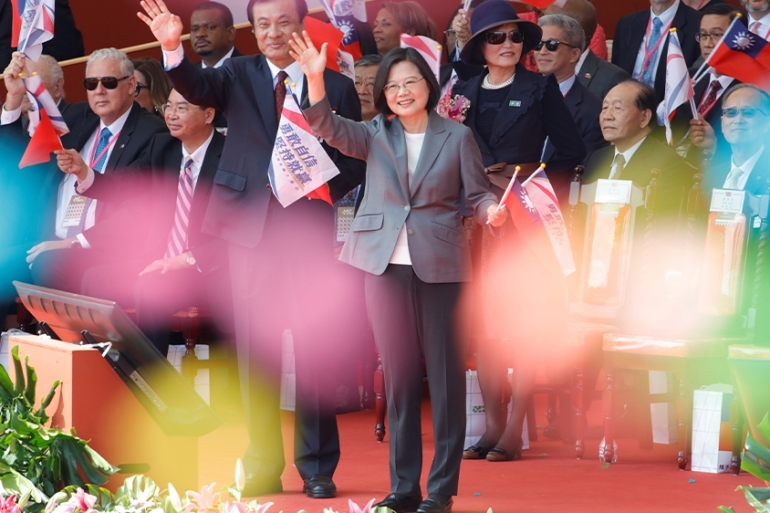 Taiwan's President Tsai Ing-wen promised to defend Taiwan's sovereignty in her annual National Day speech [Eason Lam/Reuters]