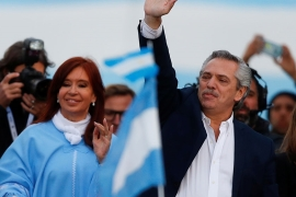 Argentina's presidential candidate Alberto Fernandez and his running mate former President Cristina Fernandez de Kirchner greet supporters during a closing campaign rally in Mar del Plata, Argentina [Agustin Marcarian/Reuters]