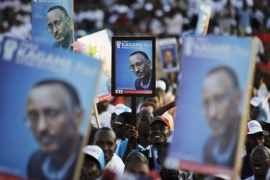 People hold posters of Rwandan President Paul Kagame at a Kigali election rally in 2010 [Finbarr O'Reilly/Reuters]