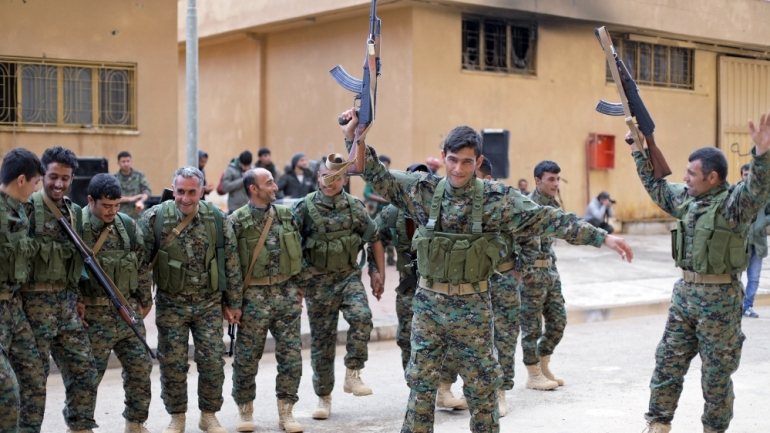 US-backed Syrian Democratic Forces (SDF) dance in Hasaka, northeastern Syria [File: Rodi Said/Reuters]