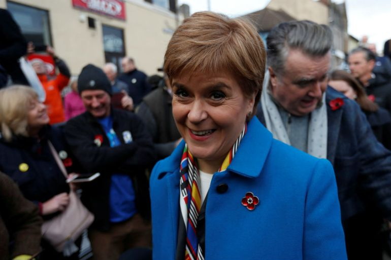 Scotland's First Minister Nicola Sturgeon hits the campaign trail with SNP (Scottish National Party) candidate John Nicolson [Russell Cheyne/Reuters]