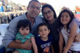 Samer Arbeed, left, pictured here with his wife, Noura, and three children, was detained by undercover Israeli forces from Ramallah on September 25 [Photo courtesy of Arbeed family]