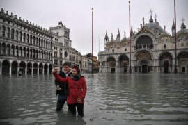 Powerful rainstorms hit Italy on Tuesday, with the worst affected areas in the south and Venice, where there was widespread flooding. [Marco Bertorello/AFP]