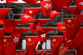 China has reportedly tightened control over its response to the Hong Kong protests with its leaders setting up a 'crisis command centre' in the Bauhinia VIlla in Shenzhen. The Bauhinia, an orchid tree flower, adorns Hong Kong's flag and currency. [File: Kin Cheung/AP Photo]
