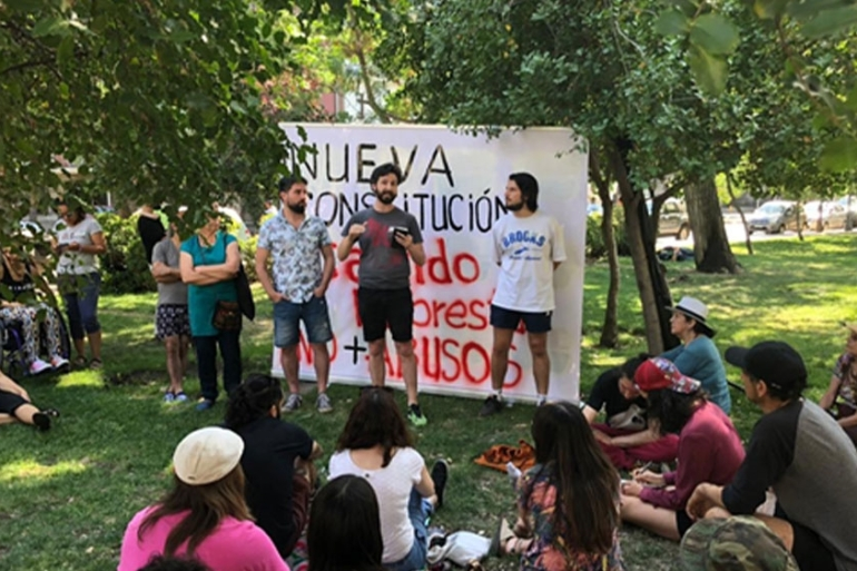 Neighbours gathering during town hall meeting in Santiago, Chile [Charis McGowan/Al Jazeera]