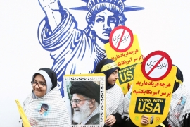 An Iranian protester holds a picture of Iranian Supreme Leader Ayatollah Ali Khamenei at an anti-US demonstration [Nazanin Tabatabaee/WANA/Reuters]