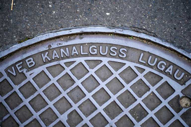Eagle-eyed opercula spotters can find manhole covers surviving from communist times in Berlin, when Volkseigene Betriebe, or Publicly Owned Enterprises, manufactured them for East German streets [Markus Schreiber/AP]