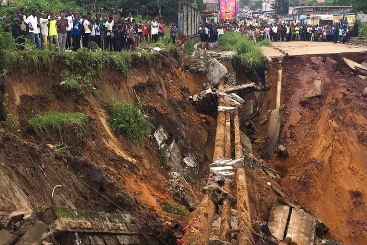 A road in the Lemba district of the DRC's capital, Kinshasa, was swept away by a landslide caused by torrential overnight rain. At least 36 people died. [Manu Kalombo/AFP]