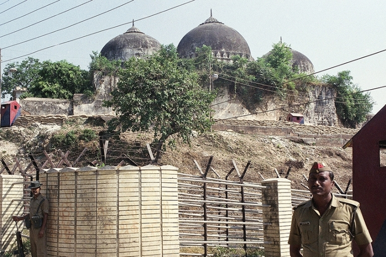 Indian security forces guard the Babri Mosque in Ayodhya before it was demolished on December 6, 1992 [Barbara Walton/The Associated Press]