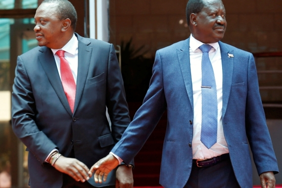 Kenya's President Uhuru Kenyatta greets opposition leader Raila Odinga after addressing a news conference at the Harambee house office in Nairobi, Kenya March 9, 2018 [Thomas Mukoya/Reuters]
