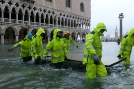 The highest tide in 50 years inundated Venice, forcing tourists and citizens to take shelter.