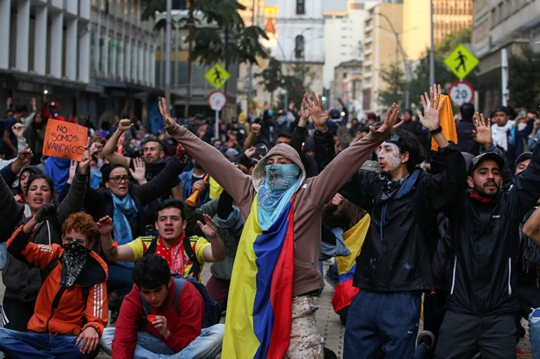 Demonstrators gesture during a protest on the second day of a national strike, in Bogota, Colombia [Luisa Gonzalez/Reuters]