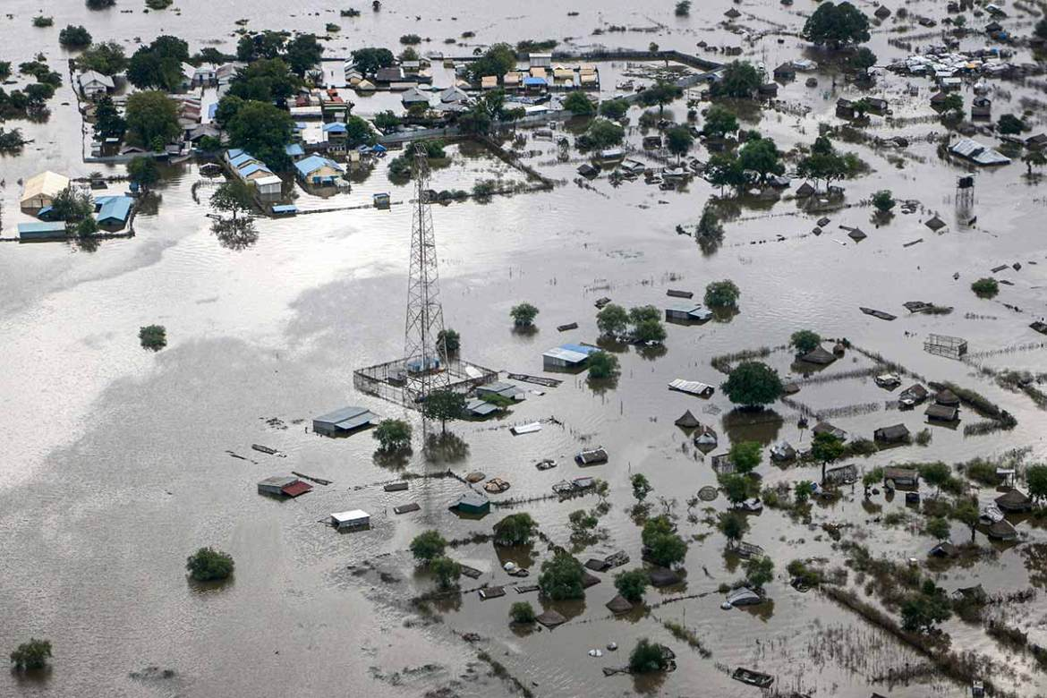An aerial picture shows flooded areas in Pibor town, Boma State, in eastern South Sudan. The governor of Boma State said 76 people have died and more than 400,000 have been displaced in recent weeks. [Peter Louis/AFP]