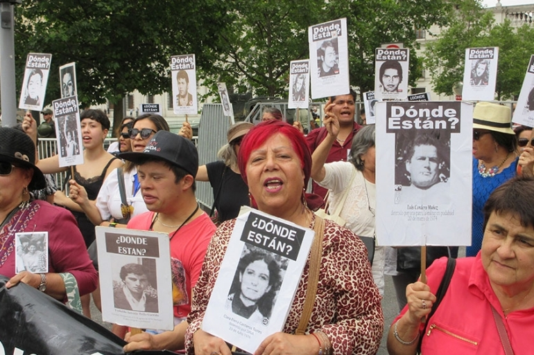Relatives of the detained-disappeared under the Pinochet dictatorship in Chile march for truth and justice every Friday [Sandra Cuffe/Al Jazeera]