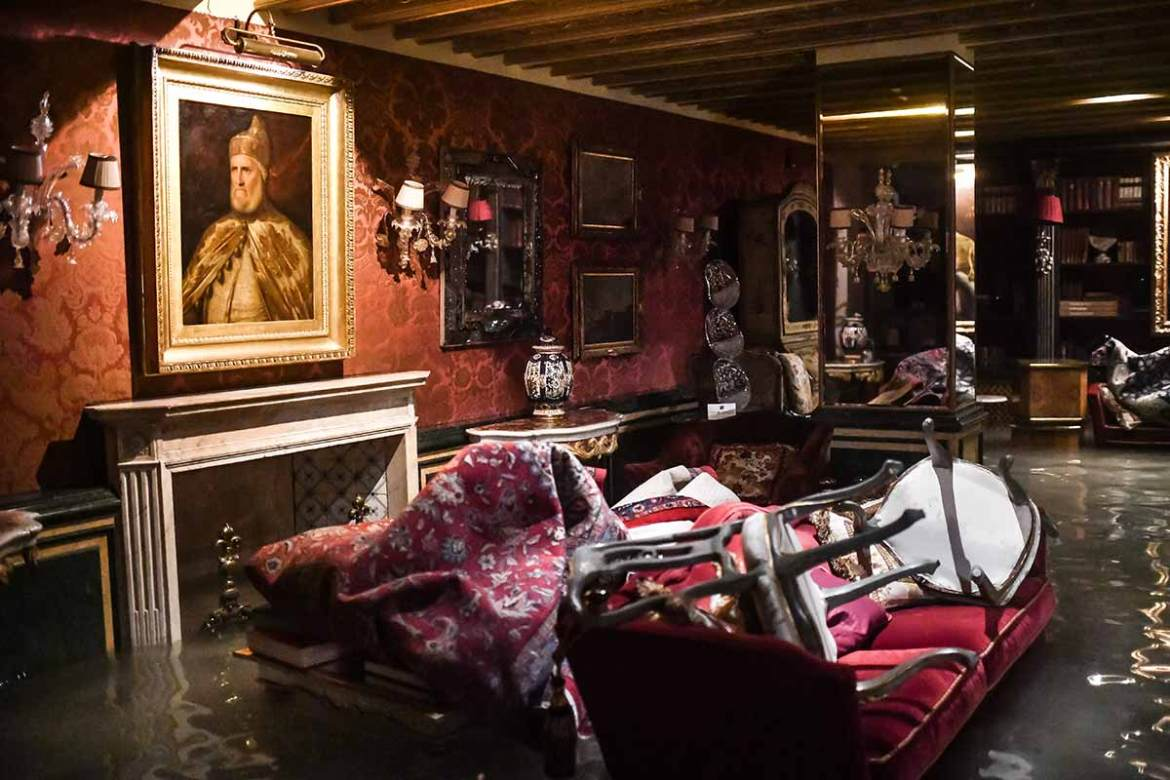 "A room in the flooded Gritti Palace in Venice during the exceptional ""acqua alta"" high tide. The historic Italian city was hit by heavy rain in the middle of the month because of a strong storm that pushed water north into the lagoon that surrounds it. [Marco Bertorello/AFP]"