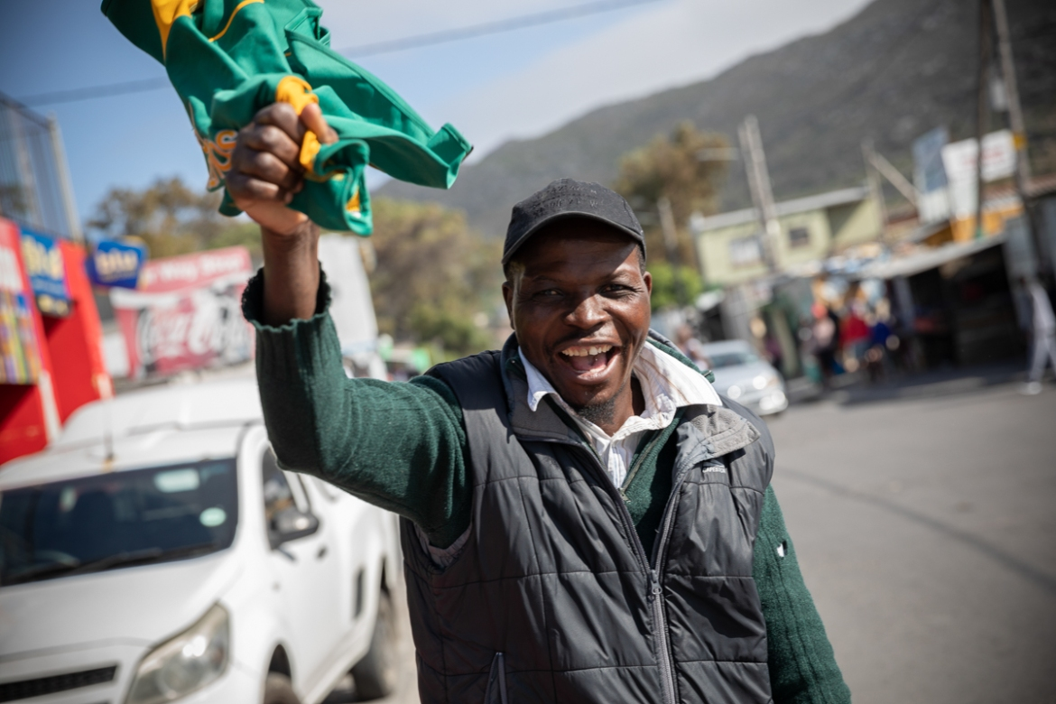 A fan in Masiphumelele informal settlement celebrates South Africa's win. [Nic Bothma/EPA]