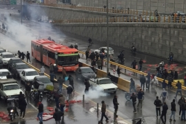 At least two people have been killed in sporadic violence surrounding the protests so far [Nazanin Tabatabaee/West Asia News Agency via Reuters]
