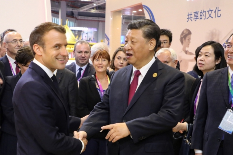 The text on climate change that will be signed by Macron and Xi on Wednesday includes a paragraph on the 'irreversibility of the Paris agreement' [Iudovic Marin/AFP]