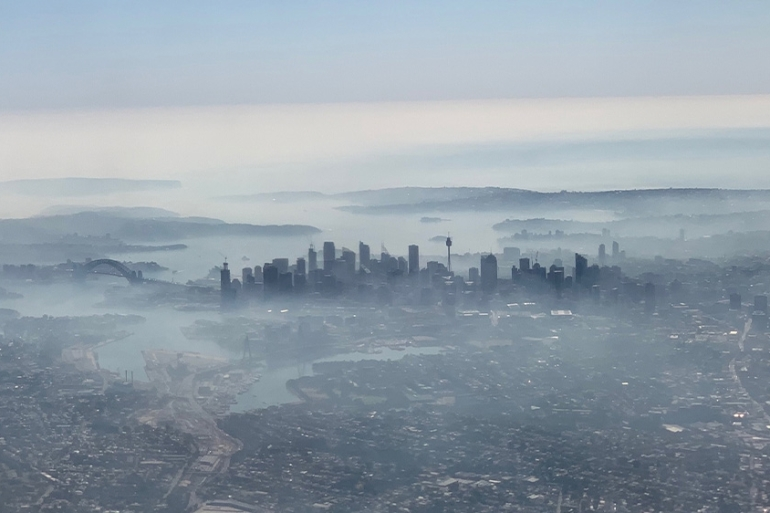 Smoke haze shrouded Sydney on Tuesday amid raging forest fires. [Neil Bennett/AAP Image via Reuters]