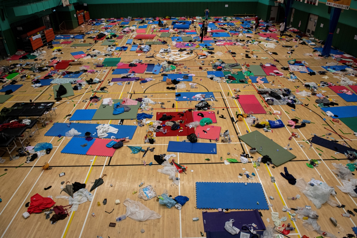 A gymnasium used by protesters as a dormitory inside the PolyU campus. [Nicolas Asfouri/AFP]