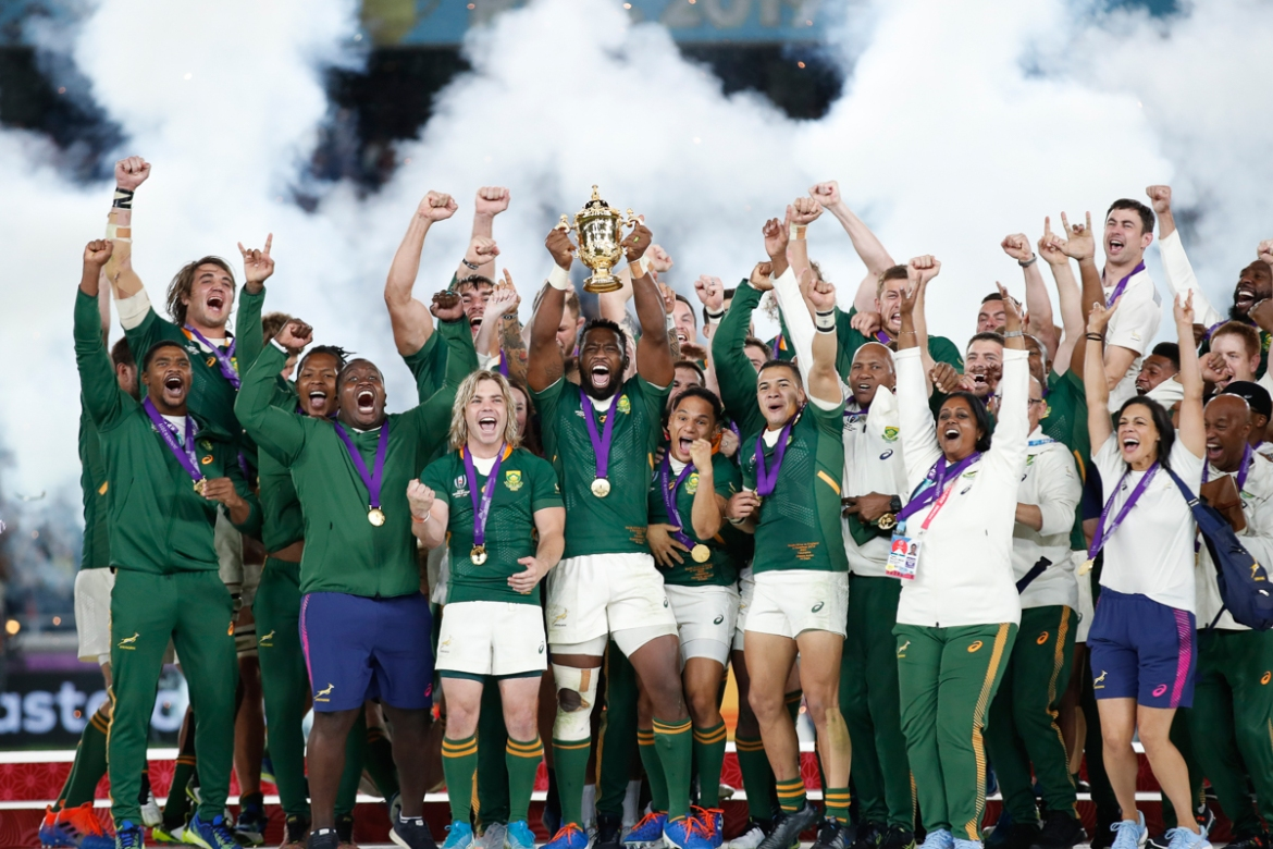 South Africa players celebrate with the Webb Ellis trophy after beating England in the final. [Matthew Childs/Reuters]