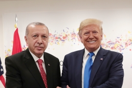 Turkey's President Erdogan, left, and his US counterpart Trump, right, shake hands during a meeting on the sidelines of the G-20 summit in Osaka, Japan [Handout/Presidential Press Service/AP Photo]