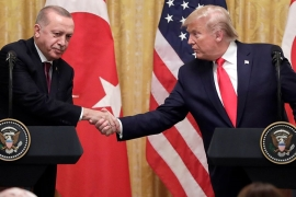 President Donald Trump shakes hands with Turkish President Recep Tayyip Erdogan during a news conference in the East Room of the White House [Evan Vucci/AP Photo]