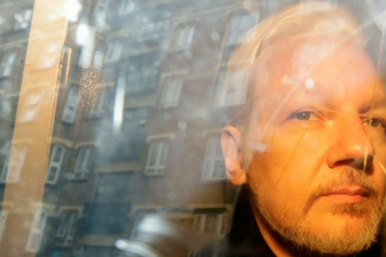 A May 1, 2019 photo showing Assange taken from a court in London [File: Matt Dunham/AP Photo]